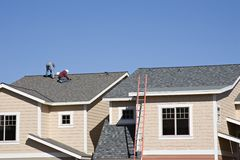 Roofers working on new roof stock image