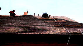 Roofers working on the roof stock video