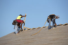 Roofers working on a wooden roof Royalty Free Stock Photos