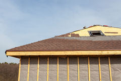 Free Roofing Construction And Building New Brick House With Skylights, Attic, Dormers And Eaves. Repair Asphalt Shingles Or Bitumen T Stock Image - 92448621
