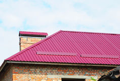 Roofing construction. Close up on metal roofing with roof protection from snow board, snow guard Royalty Free Stock Image