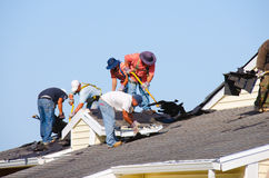 Roofing construction crew