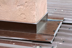 Roofing construction detail close-up. Metal panel on house roof Royalty Free Stock Photos