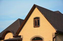 Roofing Construction House Building with Asphalt Shingles and  Different Types of Roof Design. Stock Photo