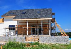 Roofing Construction. House Construction with asphalt shingles roof, skylights, terrace patio. stock image
