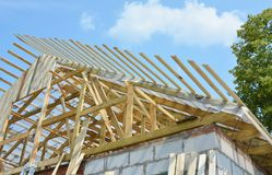 Roofing construction with rafters, roof beams, logs with waterproofing attic memmbrane. KYIV, UKRAINE - February, 13, 2018: Roofing construction with rafters royalty free stock photo