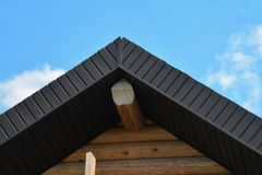Roofing construction of wooden house closeup shot of rooftop on blue sky background stock photos