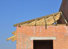 Roofing construction with wooden rafters, eaves and timber. Close up stock photography