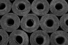Roofing felt. Rolls of Bitumen. Closeup of Rolls of new black roofing felt or bitumen. Shallow depth off field royalty free stock image