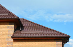 Roofing with New House Rain Gutter Waterproofing. Guttering Down pipe Fittings. Stock Images