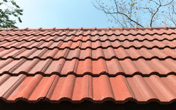 Roofing. Orange tile roof, Orange tile roof with a sky background royalty free stock image