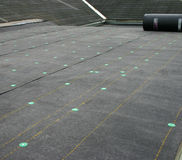 Roofing Project. Laying down the roofing felt after some roof repairs Stock Images