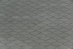 Roofing shingle 01. Roofing shingle, a grey background Stock Photography