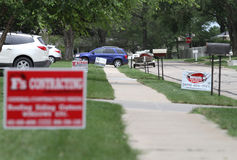 Roofing signs on neighborhood street following hail damage. Almost every home has a roofing contractor sign in their yard following hail damage from June 3, 2014 royalty free stock photo