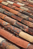 Roofing tiles. Diagonal take of portuguese weathered traditional roofing tiles Royalty Free Stock Photo