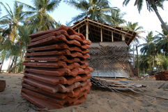 Roofing Tiles. May 18, 2005 - Locals rebuild a home lost to the tsunami when it struck Navalady, Sri Lanka. Usable roofing tiles were salvaged from the wrecks of Royalty Free Stock Photography