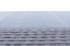 Roofing tiles being installed over waterproofing Royalty Free Stock Image