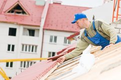 Roofing tiling works Royalty Free Stock Images
