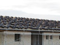 Roofing work at new build. Modern roof tile. Roofing with metal tile. stock photos