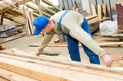 Roofing works with measuring tape Royalty Free Stock Images