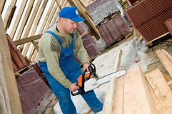 Roofing works with portable saw Stock Photos