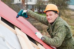 Roofing works with screwdriver Royalty Free Stock Images