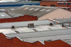 Roofs. Factory rooftops and red brickwalls Royalty Free Stock Photos