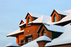 Roofs. Roof of residential house in winter with snow Royalty Free Stock Image