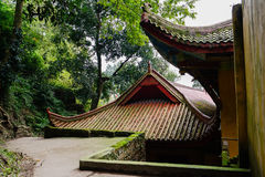 Roofs of aged Chinese buildings on woody mountainside Royalty Free Stock Image