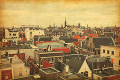 Roofs of Amsterdam,  Netherlands. Photo in retro style. Added paper texture Royalty Free Stock Photos