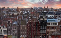 Roofs of Amsterdam at sunset, Netherlands. Top view of old-time houses in Amsterdam, Netherlands Stock Photography