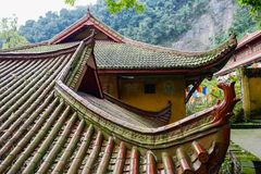 Roofs of ancient Chinese buildings on woody mountainside Stock Photography