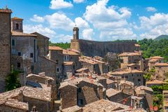 Free Roofs And Buildings Of Little Medieval City Of Sorano, Tuscany, Italy, With Hills And Blue Sky In Background Royalty Free Stock Image - 156289756
