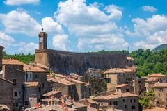 Free Roofs And Buildings Of Little Medieval City Of Sorano, Tuscany, Italy, With Hills And Blue Sky In Background Stock Images - 156289764