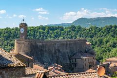 Free Roofs And Buildings Of Little Medieval City Of Sorano, Tuscany, Italy, With Hills And Blue Sky In Background Royalty Free Stock Photos - 156289908