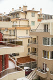 Roofs and balconies in the snow in Pomorie, Bulgaria royalty free stock photography