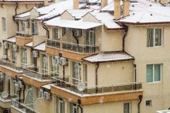 Roofs and balconies in the snow in Pomorie, Bulgaria Stock Photos