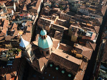 Roofs of Bolgna seen from Asinelli Tower. View of roofs of Bologna houses and of church Santi Bartolomeo e Gaetano a Renaissance style church in central Bologna Royalty Free Stock Image