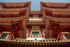 Roofs of  Buddha Tooth Temple in Singapore. Bright colours of buddhistic temple in Singapore chinatown Stock Photos