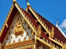 Roofs at Buddhist temple under blue sky, Thailand Royalty Free Stock Photography