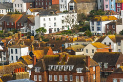 Roofs of buildings covered with green moss, seaside spot seen fr Royalty Free Stock Image