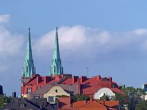 Roofs and church towers at sunset. Roofs and church towers lit by sunset, Helsinki Stock Images