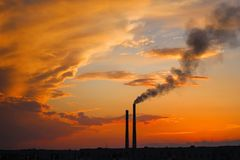 Dark smoke coming from the thermal power plant pipe. stock images