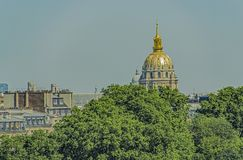 Roofs of the city. Variety of urban roofs in Paris, from the green foliage of parks, to the domes of palaces Royalty Free Stock Image
