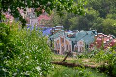 Roofs of colorful beautiful houses surrounded by trees stock photography