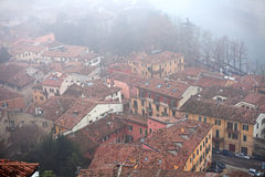 Roofs covered with fog in Verona royalty free stock photo