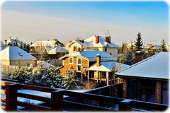 Roofs covered with snow. Rooftops and trees covered with snow stock image