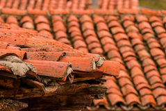 Roofs. Detail of a roof of a house with Arabic tiles Royalty Free Stock Photography