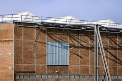 The roofs of a factory hall. The roofs of a factory building in which large yachts are built on the edge of Vlissingen Stock Images