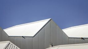 The roofs of a factory hall. The roofs of a factory building in which large yachts are built on the edge of Vlissingen Royalty Free Stock Photo